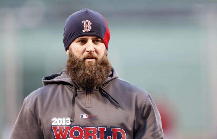 Boston Red Sox first baseman Mike Napoli (12) warms up during batting practice prior to game two of the MLB baseball World Series against the St. Louis Cardinals at Fenway Park. (Mark L. Baer/USA TODAY Sports)