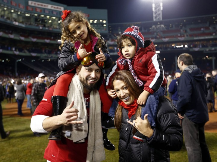 Boston Red Sox right fielder Shane Victorino (right) celebrates with his wife, Melissa, and children Kali'a (top, left) and Kingston after winning the World Series at Fenway Park. (Mark L. Baer/USA TODAY Sports)
