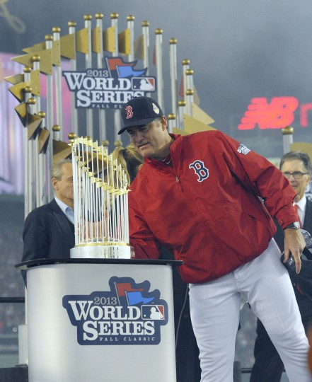 Boston Red Sox manager John Farrell looks at the World Series championship trophy. (Bob DeChiara/USA TODAY Sports)