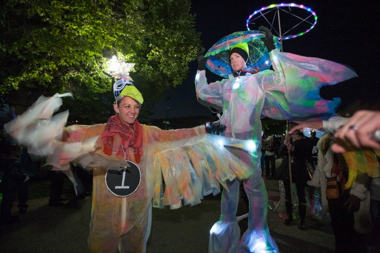 "Whitney Brown, left, of Patterson Park, and Joe Meduza, of Mt. Vernon, dressed as ""Firebirds"" and stood toward the front of the annual Great Halloween Lantern Parade at Patterson Park. (Nate Pesce/For the Baltimore Sun)"