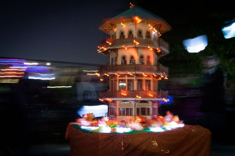 A light-up scale model of the Patterson Park Pagoda is pulled on a cart in the annual Halloween Lantern Parade, October 26, 2013. (Nate Pesce/For the Baltimore Sun)