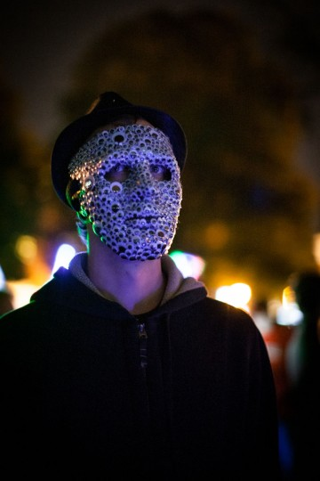 Tim Hofmann of Lauraville, Md., wears a mask made of googly eyes at the annual Halloween Lantern Parade through Patterson Park, on Saturday, October 26. (Nate Pesce/For the Baltimore Sun)