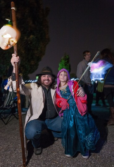Torberg Tonnessen, of Patterson Park, and his daughter Brigid, 5, pose for a picture with their costumes and homemade lanterns at the annual Halloween Lantern Parade in Patterson Park. (Nate Pesce/For the Baltimore Sun)