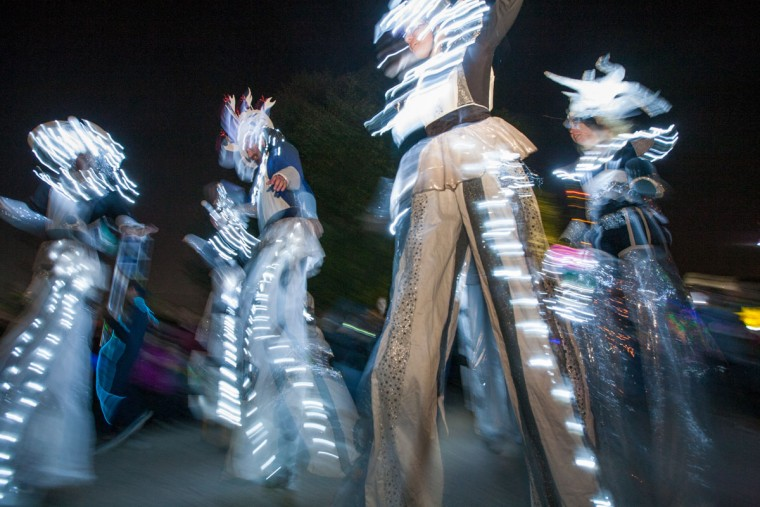 Stilt-walkers move through the parade route the annual Halloween Lantern Parade through Patterson Park, on Saturday, October 26. (Nate Pesce/For the Baltimore Sun)