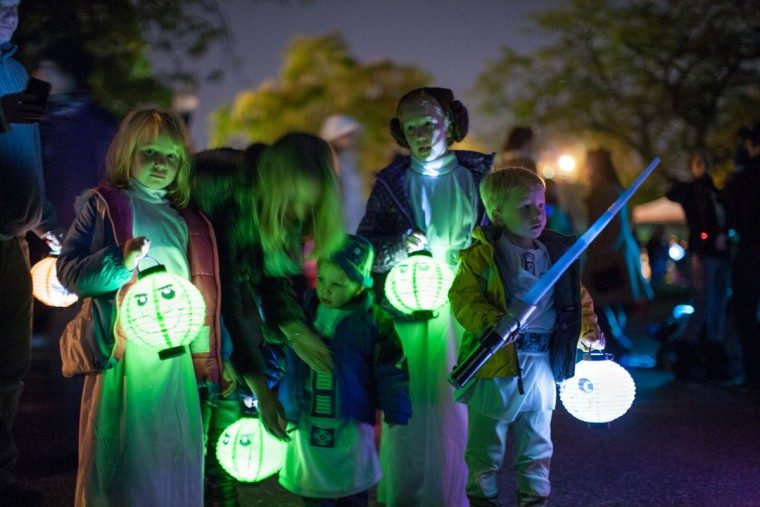 The Devault family from Towson, Md., carries lanterns during the annual Halloween Lantern Parade through Patterson, October 26, 2013. (Nate Pesce/For the Baltimore Sun)