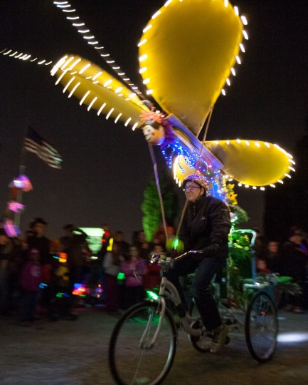 A kinetic buttery attached to a bicycle moves down the parade route during the annual Halloween Lantern Parade through Patterson Park, October 26, 2013. (Nate Pesce/For the Baltimore Sun)
