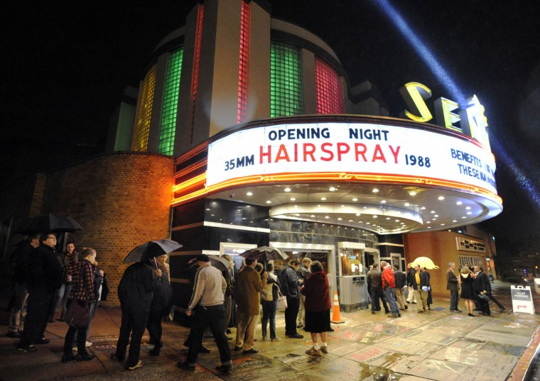 "A crowd gathers outside the Senator Theatre on the night of the newly renovated theater's reopening, Thursday, Oct. 10, 2013, in Baltimore. The historic movie house featured a showing of John Waters' ""Hairspray"" to mark the film's 25th anniversary. (Steve Ruark/ for The Baltimore Sun)"