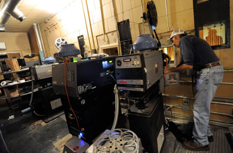 Projectionist Dominic Wagner of Baltimore works during the reopening. (Steve Ruark/ for The Baltimore Sun)