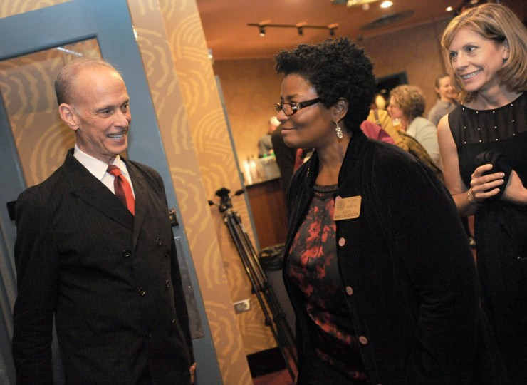 Filmmaker John Waters, left, talks to Del. Mary Washington, second from left, at the reopening. (Steve Ruark/ for The Baltimore Sun)