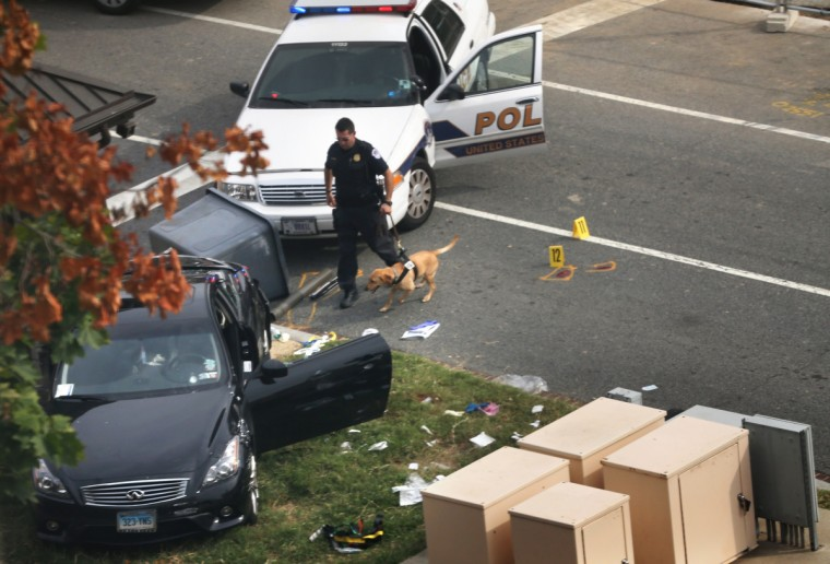 A police officer checks out a car on grass with his canine near the U.S. Capitol October 3, 2013 on Capitol Hill in Washington, DC. The US Capitol and the White House were placed on lockdown after an 'active shooter' situation was reported. (Mark Wilson/Getty Images)