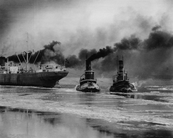 A pair of tugboats pull a cargo ship safely to its destination at the port of Baltimore in September 1949. (Robert F. Kniesche/Baltimore Sun)
