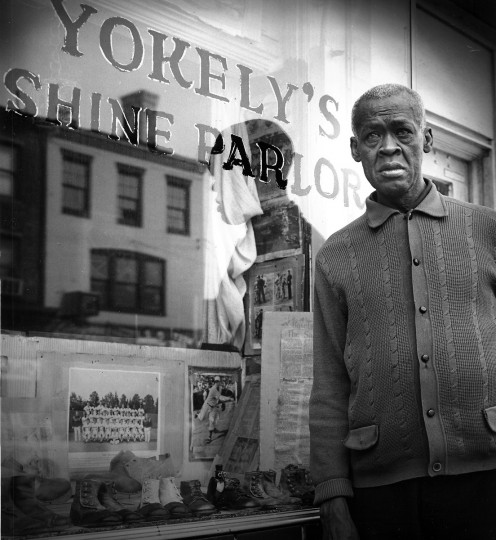 Laymon Yokely pitched six no-hitters for the Baltimore Black Sox of the American Negro League and posted 42 wins for the Philadelphia Stars. In July of 1970, he posed for a photo at his shoeshine stand on Pennsylvania Avenue. (Ellis Malashuk/Baltimore Sun)