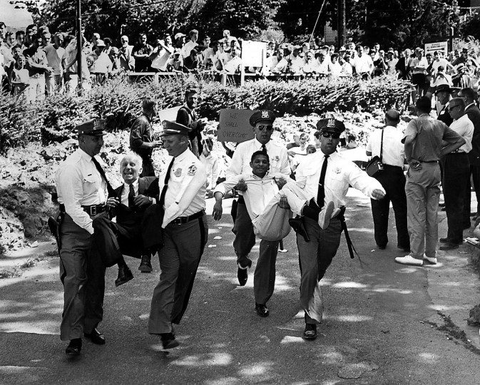Baltimore County policemen carry anti-segregation demonstrators from Gwynn Oak Park in July 1963. Protestors numbered in the hundreds. (Walter M. McCardell/Baltimore Sun)