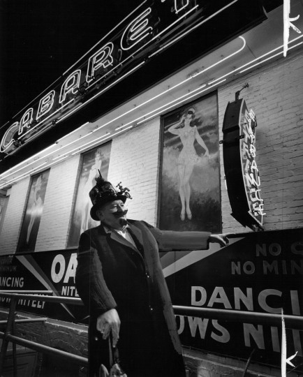 Barker Joe Martin lures customers into the Oasis cabaret on The Block in May 1967. The Oasis, along with Kay's, the Miami, the Two O'Clock Club and other establishments, did a booming business. (Richard Stacks/Baltimore Sun)