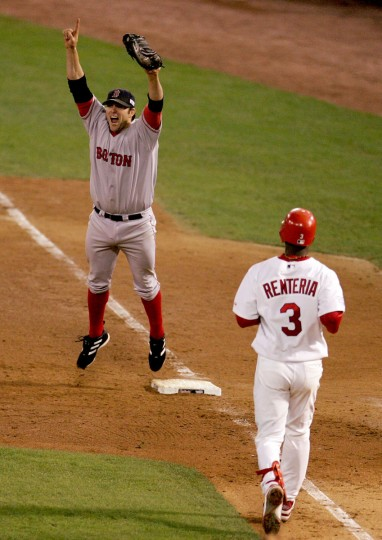 Doug Mientkiewicz #13 of the Boston Red Sox celebrates the final out and defeating the St. Louis Cardinals 3-0 in game four of the World Series on October 27, 2004 at Busch Stadium in St. Louis, Missouri. ( Al Bello/Getty Images)