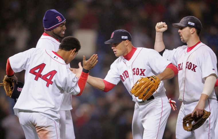 Gabe Kapler #19 of the Boston Red Sox and teammates celebrate winning game two of the World Series on October 24, 2004 at Fenway Park in Boston, Massachusetts. The Boston Red Sox defeated the St. Louis Cardinals 6-2 to take a 2-0 game lead. (Elsa/Getty Images)