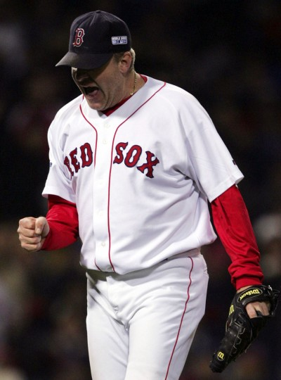 Boston Red Sox pitcher Curt Schilling celebrates the double play ending of the fifth inning against the St. Louis Cardinals in Game 2 of the World Series in Boston, Sunday, Oct. 24, 2004. (Charles Krupa/AP Photo)