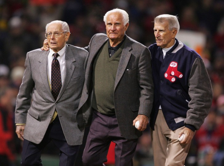 (L-R) Boston Red Sox Hall of famers Dom Dimaggio, Bobby Doerr and Johnny Pesky walk out onto the field to throw the first pitch of game two of the World Series between the St. Louis Cardinals and the Boston Red Sox on October 24, 2004 at Fenway Park in Boston, Massachusetts. (Elsa/Getty Images)