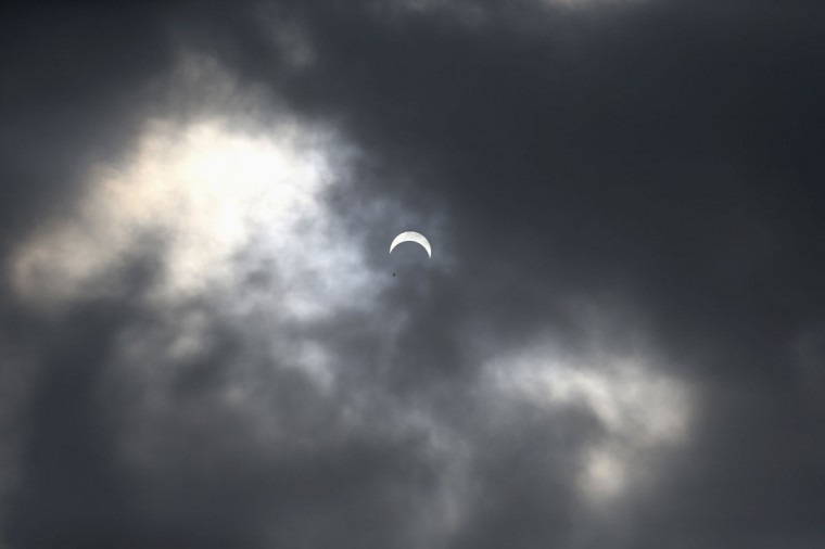 The sun is partially eclipsed in Lagos November 3, 2013. Skywatchers across the world are in for a treat Sunday as the final solar eclipse of 2013 takes on a rare hybrid form. (Akintunde Akinleye/Reuters)
