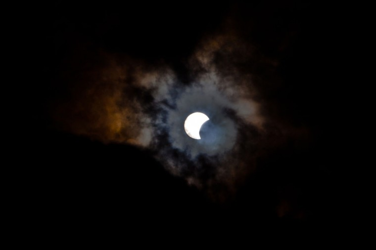 This picture taken on November 3, 2013 shows a rare hybrid solar eclipse through clouds from the Canary Island of Tenerife. A rare solar eclipse swept across parts of Africa, Europe and the United States today as the moon blocks the sun either fully or partially, depending on the location. The width of the shadow of the eclipse was 58 km and the maximum duration of totality, the maximum time that the moon covered the sun completely, was 1m 40s, on the Spanish Canary island of Tenerife. (Desiree Martin/AFP Photo)