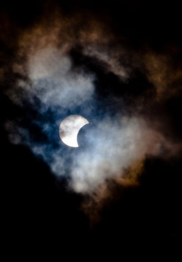 This picture taken on November 3, 2013 shows a rare hybrid solar eclipse through clouds from the Canary Island of Tenerife. A rare solar eclipse swept across parts of Africa, Europe and the United States today as the moon blocks the sun either fully or partially, depending on the location. The width of the shadow of the eclipse was 58 km and the maximum duration of totality, the maximum time that the moon covered the sun completely, was 1m 40s, on the Spanish Canary island of Tenerife. (Desiree Martin/AFP Getty Photo)