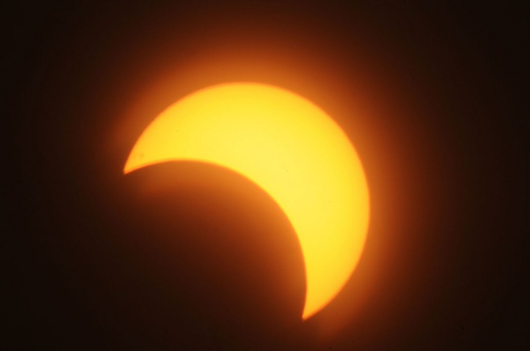 A partial solar eclipse is seen over the Sudanese capital Khartoum, on November 3, 2013. The rare solar eclipse will sweep across parts of Africa, Europe and the United States as the moon blocks the sun either fully or partially, depending on the location. (Ebrahim Hamid/AFP Photo)