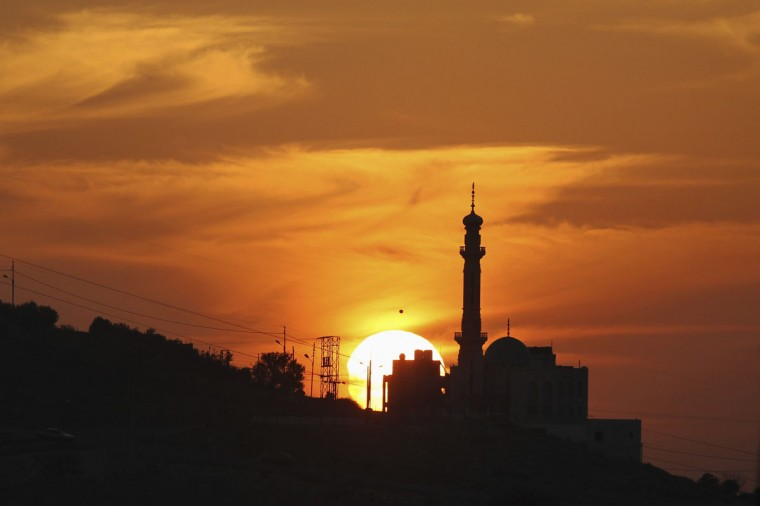 A partially-eclipsed sun is seen in Amman November 3, 2013. Skywatchers across the world are in for a treat Sunday as the final solar eclipse of 2013 takes on a rare hybrid form. (Muhammad Hamed/Reuters)