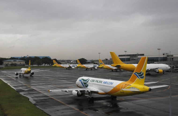 Cebu Pacific airways planes park at the tarmac at Ninoy Aquino International airport in Pasay city, metro Manila November 8, 2013, after nearly 200 local flights have been suspended due to Typhoon Haiyan that hit central Philippines on Friday. Typhoon Haiyan, the strongest storm on earth this year, slammed into the Philippines' central islands on Friday forcing millions of people to move to safer ground and storm shelters, cutting power and phone lines, and grounding air and sea transport. (Romeo Ranoco/Reuters)