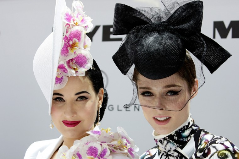 Dita von Teese (L) and model Coco Rocha look on during judging of Myer Fashions on the Field during Melbourne Cup Day at Flemington Racecourse on November 5, 2013 in Melbourne, Australia. (Lisa Maree Williams/Getty Images for the VRC)