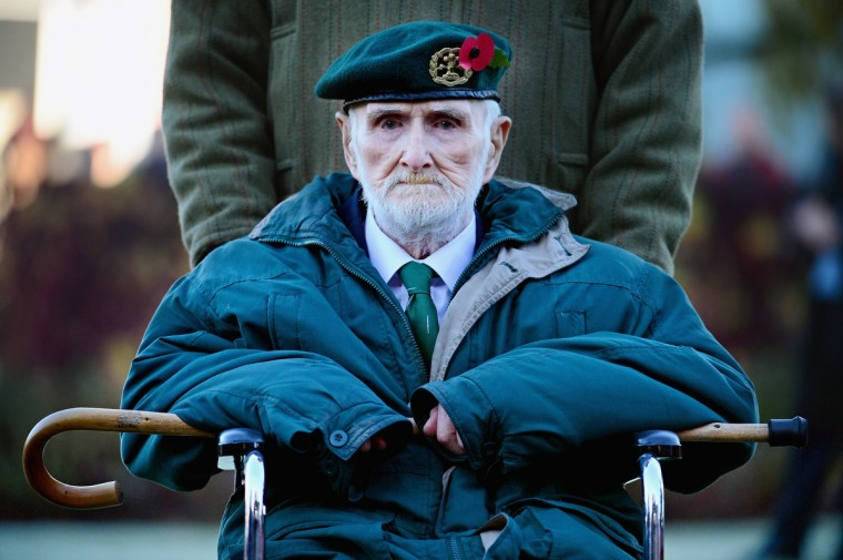 A veteran attends a Remembrance Day ceremony along with members of Scotland's armed forces and other veterans to commemorate and pay respect to the sacrifice of service men and women who fought in the two World Wars and subsequent conflicts on November 10, 2013 in Fort William, Scotland. People across the UK gathered to pay tribute to service personnel who have died during conflicts, as part of the annual Remembrance Sunday ceremonies. (Jeff J Mitchell/Getty Images)