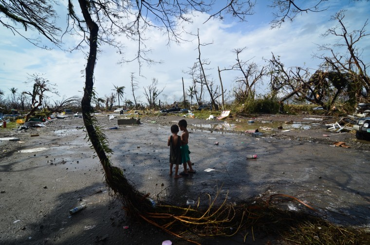 Two young boys look at the devastation in the aftermath of typhoon Haiyan on November 10, 2013 in Tacloban City, Leyte, Philippines. Typhoon Haiyan, packing maximum sustained winds of 195 mph (315 kph), slammed into the southern Philippines and left a trail of destruction in multiple provinces, forcing hundreds of thousands to evacuate and making travel by air and land to hard-hit provinces difficult. Around 10,000 people are feared dead in the strongest typhoon to hit the Philippines this year. ( Dondi Tawatao/Getty Images)