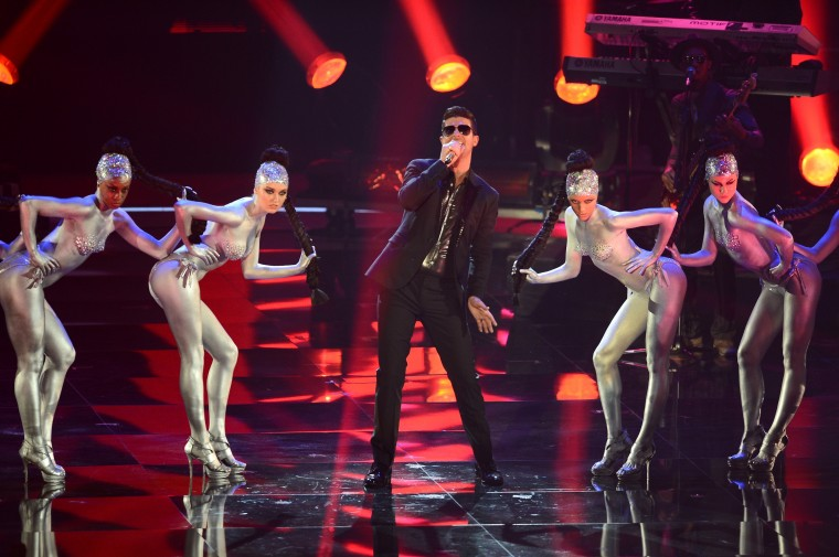 Robin Thicke performs onstage during the MTV EMA's 2013 at the Ziggo Dome on November 10, 2013 in Amsterdam, Netherlands. (Ian Gavan/Getty Images for MTV)