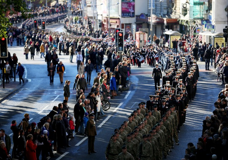 Locals line the street as members of the armed forces and veterans march during a Remembrance Day on November 10, 2013 in Bristol, England. People across the UK gathered to pay tribute to service personnel who have died in the two World Wars and subsequent conflicts, as part of the annual Remembrance Sunday ceremonies. (Matt Cardy/Getty Images)