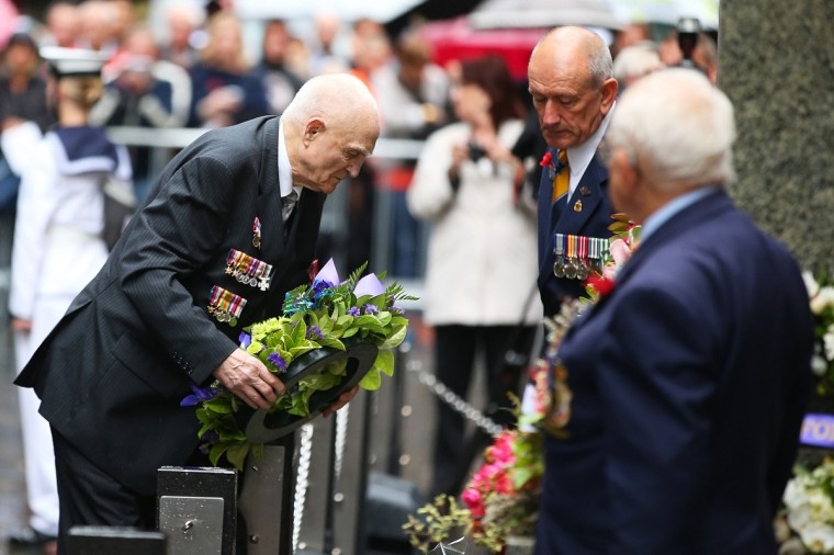 A war veteran lays a wreath at the Cenotaph during the Rememberance Day Service held at the Cenotaph, Martin Place on November 11, 2013 in Sydney, Australia. Remembrance Day marks the anniversary of the armistice which ended the First World War. A one minute silence is called at 11.00am on the 11th day of the 11th month to remembers the members of armed forces who were killed at battle. (Brendon Thorne/Getty Images)