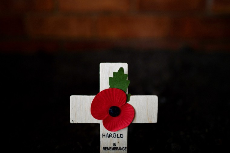 A lone cross adorned with a poppy is seen at the funeral of World War II veteran Harold Percival at Lytham Park Cemetery on November 11, 2013 in Lytham St Annes, England. Hundreds of strangers attended the funeral of former RAF Bomber Command ground crew member, Harold Jellicoe Percival, following an online campaign sparked by a notice placed in a newspaper by the funeral directors. (Nigel Roddis/Getty Images)
