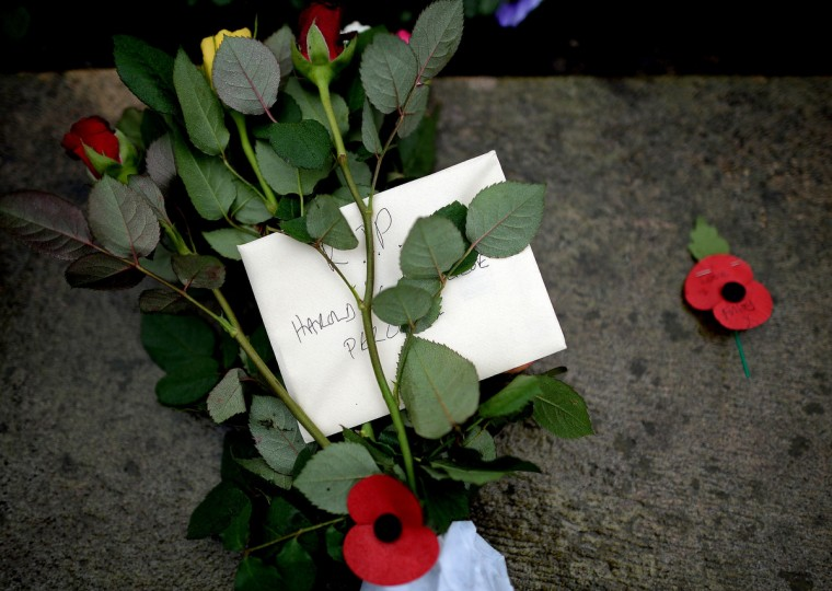 A floral tribute left at the funeral of World War II veteran Harold Percival at Lytham Park Cemetery on November 11, 2013 in Lytham St Annes, England. Hundreds of strangers attended the funeral of former RAF Bomber Command ground crew member, Harold Jellicoe Percival, following an online campaign sparked by a notice placed in a newspaper by the funeral directors. (Nigel Roddis/Getty Images)