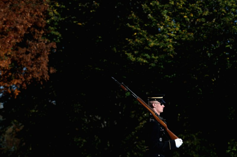 A member of the military color guard stands at attention before a ceremony where U.S. President Barack Obama will lay a commemorative wreath for Veterans Day at the Tomb of the Unknowns at Arlington National Cemetery on November 11, 2013 in Arlington, Virginia. For Veterans Day, President Obama is paying tribute to military veterans past and present who have served and sacrificed their lives for their country. (Mark Wilson/Getty Images)