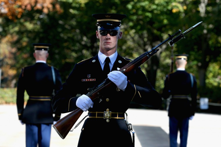 Members of the military color guard stands at attention before a ceremony where U.S. President Barack Obama will lay a commemorative wreath for Veterans Day at the Tomb of the Unknowns at Arlington National Cemetery on November 11, 2013 in Arlington, Virginia. For Veterans Day, President Obama is paying tribute to military veterans past and present who have served and sacrificed their lives for their country. (Mark Wilson/Getty Images)