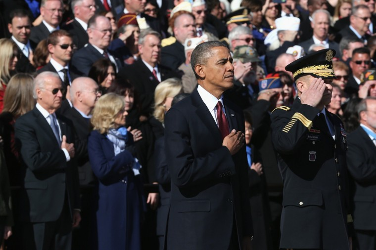 U.S. President Barack Obama (C) looks on during a ceremony on Veterans Day at the Tomb of the Unknowns at Arlington National Cemetery on November 11, 2013 in Arlington, Virginia. For Veterans Day, President Obama is paying tribute to military veterans past and present who have served and sacrificed their lives for their country. (Mark Wilson/Getty Images)