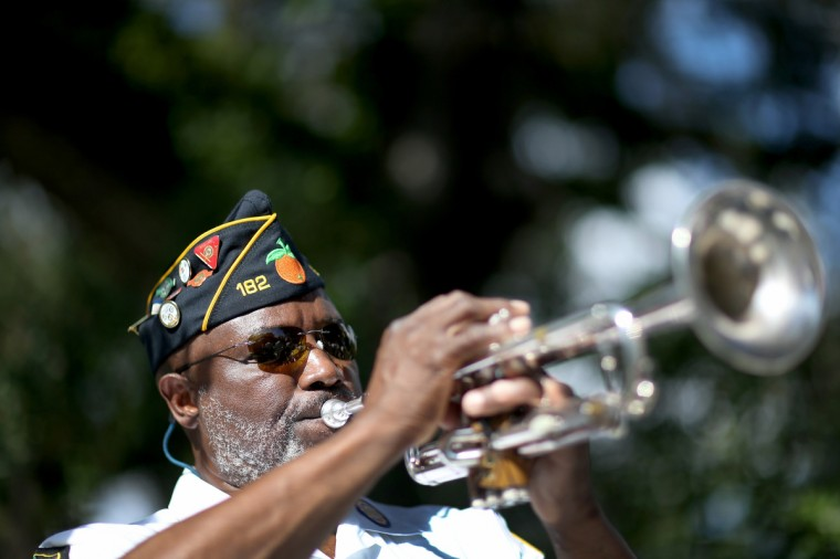 Cyril Bullard retired from the United States Army plays the trumpet during a Veterans Day ceremony at the Coconut Grove Bahamian cemetery on November 11, 2013 in Coconut Grove, Florida. The ceremony was held by the Coconut Grove American Legion Post #182 in honor of those veterans who have served the United States. (Joe Raedle/Getty Images)