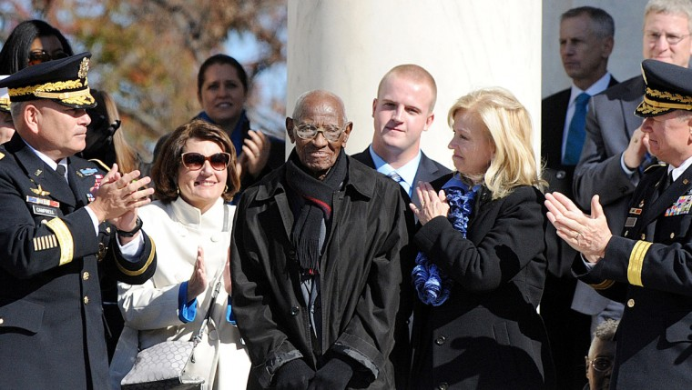 Richard Overton (C) , 107 years-old, who is believed to be America's oldest living veteran is acknowledged by U.S. President Barack Obama during a ceremony to honor veterans at the Tomb of the Unknowns on Veterans Day at Arlington National Cemetery on November 11, 2013 in Arlington, Virginia. For Veterans Day, President Obama is paying tribute to military veterans past and present who have served and sacrificed their lives for their country. (Olivier Douliery-Pool/Getty Images)