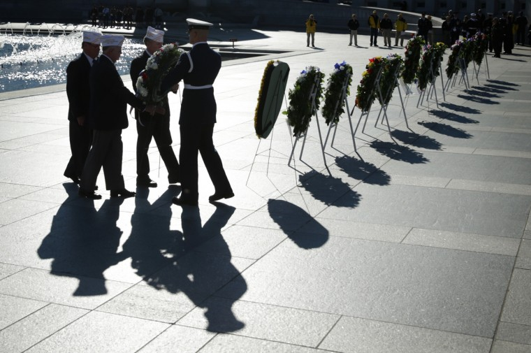 Members of AMVETS lay a wreath during an event to celebrate Veterans Day November 11, 2013 at the National World War II Memorial in Washington, DC. The U.S. Postal Service unveiled the World War II Medal of Honor Forever stamps during the event to honor the 464 recipients of the award. (Alex Wong/Getty Images)