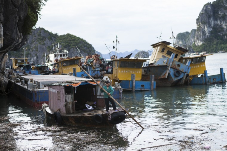 A man pushes his boat through the debris on the morning after Typhoon Haiyan made landfall in Halong City, Vietnam. Typhoon Haiyan, which has left thousands dead after it swept through the Philippines, has made landfall in Vietnam. 600,000 people were evacuated in preparation, as winds of up to 120 km/h battered the coast line. (Tim Barker/Getty Images)