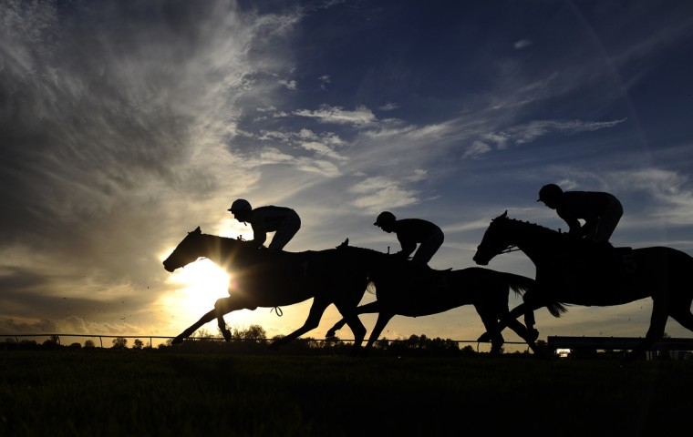 The sun begins to set at Huntingdon racecourse in Huntingdon, England. (Alan Crowhurst/Getty Images)