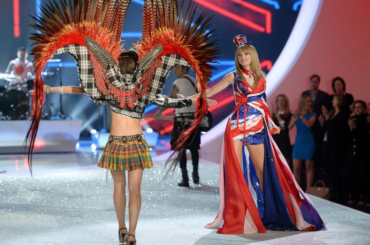 Singer Taylor Swift (R) walks the runway at the 2013 Victoria's Secret Fashion Show at Lexington Avenue Armory on November 13, 2013 in New York City. (Dimitrios Kambouris/Getty Images)