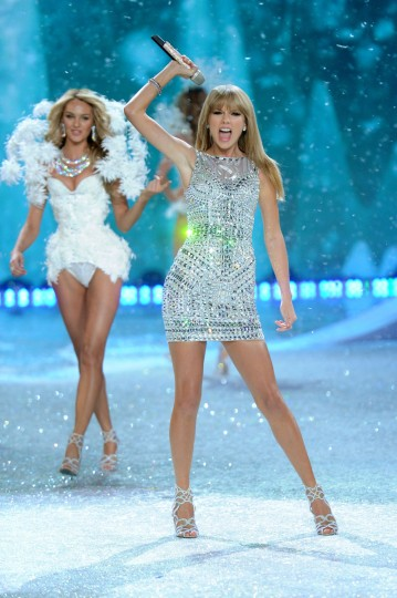 Singer Taylor Swift (R) performs and model Candice Swanepoel walks the runway at the 2013 Victoria's Secret Fashion Show at Lexington Avenue Armory on November 13, 2013 in New York City. (Jamie McCarthy/Getty Images)