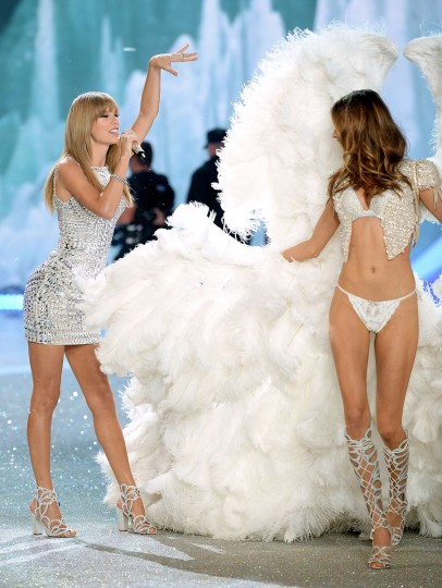 Singer Taylor Swift (L) performs and model Behati Prinsloo walks the runway at the 2013 Victoria's Secret Fashion Show at Lexington Avenue Armory on November 13, 2013 in New York City. (Dimitrios Kambouris/Getty Images)