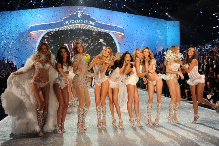 (L-R) Models Magdalena Frackowiak, Lily Aldridge, Karlie Kloss, Doutzen Kroes, Adriana Lima, Candice Swanepoel, Behati Prinsloo, Lindsay Ellingson, and Alessandra Ambrosio walk the runway at the 2013 Victoria's Secret Fashion Show at Lexington Avenue Armory on November 13, 2013 in New York City. (Dimitrios Kambouris/Getty Images)