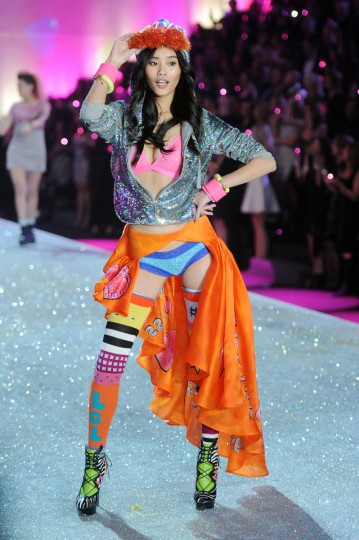 Model Ming Xi walks the runway at the 2013 Victoria's Secret Fashion Show at Lexington Avenue Armory on November 13, 2013 in New York City. (Jamie McCarthy/Getty Images)