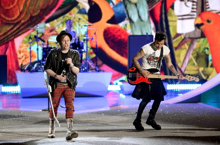 Musicians Patrick Stump (L) and Pete Wentz of the band Fall Out Boy perform at the 2013 Victoria's Secret Fashion Show at Lexington Avenue Armory on November 13, 2013 in New York City. (Dimitrios Kambouris/Getty Images)